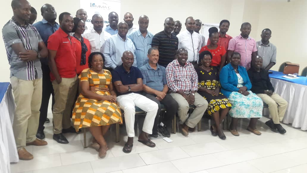 EMMAC Team of Financial Advisors from South Hub (Lindi and Mtwara); Southern Highlands (Njombe and Iringa), Lake Zone Hub (Mwanza and Shinyanga) and two CUSO T-LED representatives, namely Joan Cooke, smiling lady seating from left and David Cooke third from left.